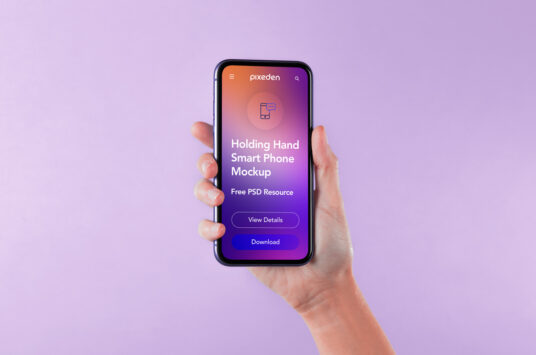 Free Download Holding iPhone 12 Mockup PSD