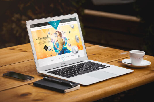 Free Download MacBook Air on Coffee Shop Table Mockup PSD