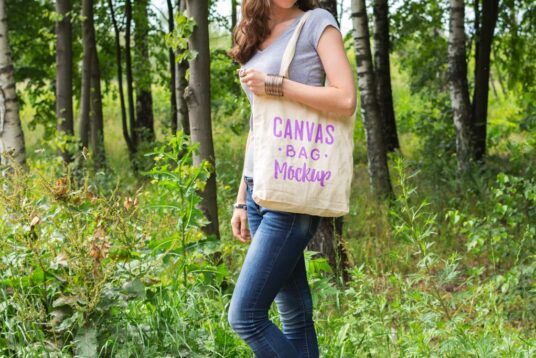 Free Download Women Holding Canvas Bag Mockup PSD