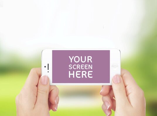 Free Download Women Holding iPhone Mockup PSD